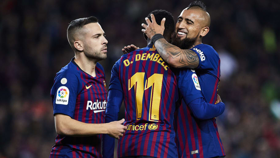 BARCELONA, SPAIN - DECEMBER 22: Jordi Alba Ousmane Dembele and Arturo Vidal of FC Barcelona celebrating their team's opening goal during the La Liga match between FC Barcelona and RC Celta de Vigo at Camp Nou on December 22, 2018 in Barcelona, Spain. (Photo by Quality Sport Images/Getty Images)