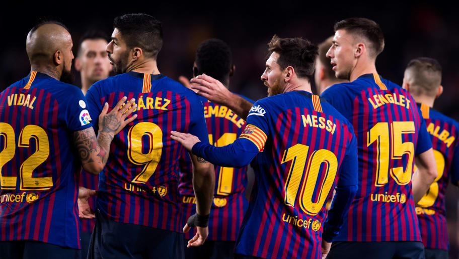 BARCELONA, SPAIN - DECEMBER 22: Lionel Messi of FC Barcelona celebrates with teammates after scoring his team's second goal during the La Liga match between FC Barcelona and RC Celta de Vigo at Camp Nou on December 22, 2018 in Barcelona, Spain. (Photo by Alex Caparros/Getty Images)
