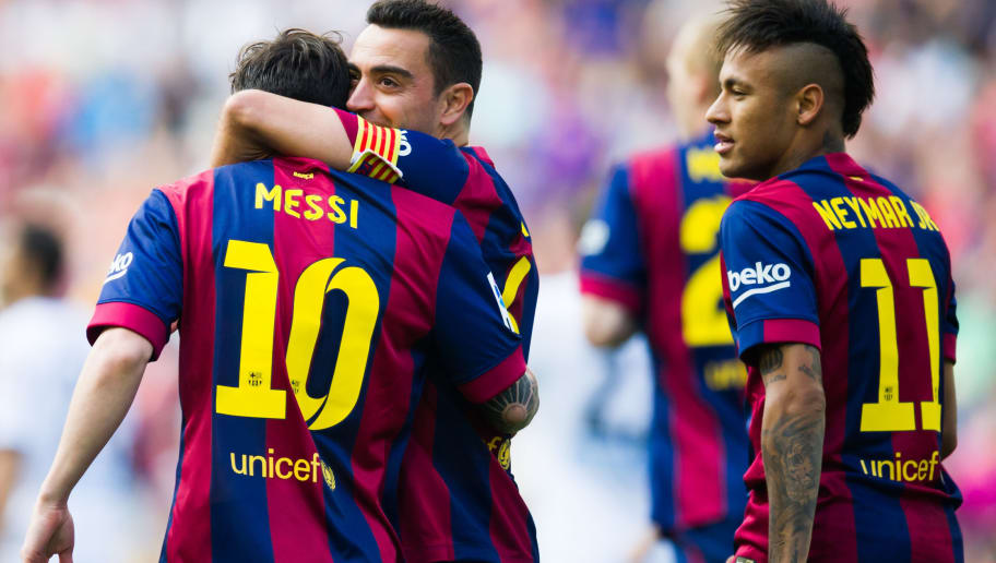 BARCELONA, SPAIN - MAY 23: Lionel Messi of FC Barcelona is congratulated by his teammate Xavi Hernandez (C) next to Neymar Santos Jr after scoring the opening goal during the La Liga match between FC Barcelona and RC Deportivo La Coruna at Camp Nou on May 23, 2015 in Barcelona, Spain. (Photo by Alex Caparros/Getty Images)