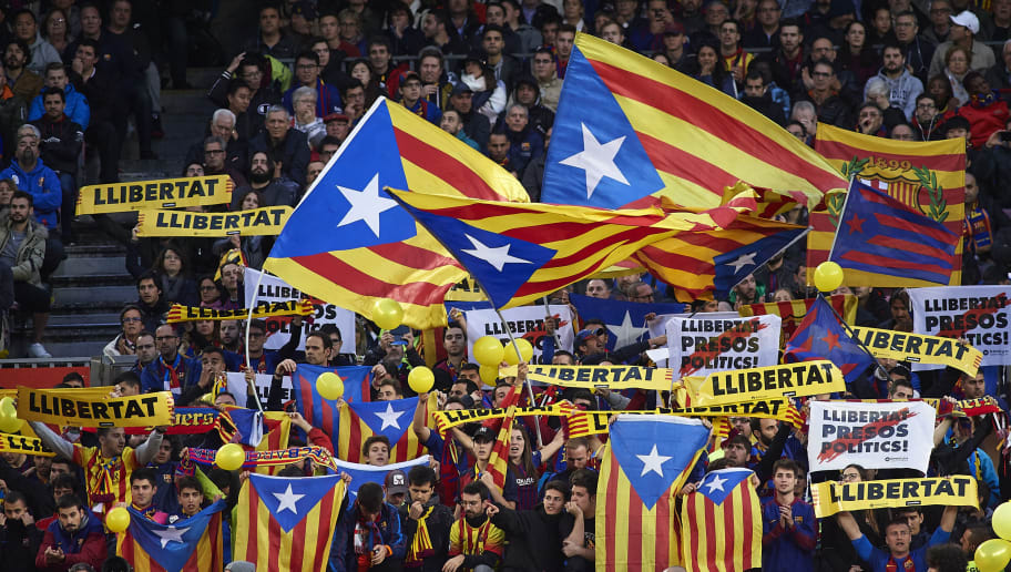 BARCELONA, SPAIN - OCTOBER 28:  Barcelona fans wave Catalan independence flags during the La Liga match between FC Barcelona and Real Madrid CF at Camp Nou on October 28, 2018 in Barcelona, Spain.  (Photo by Quality Sport Images/Getty Images )