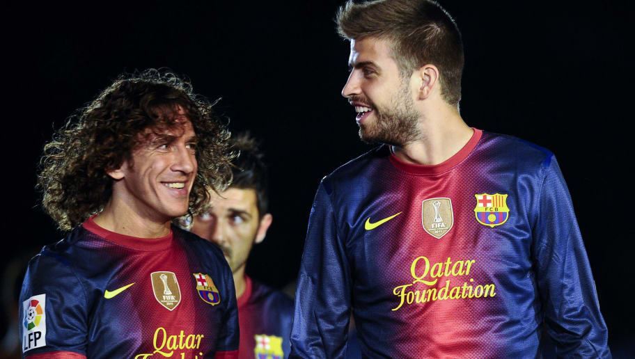 BARCELONA, SPAIN - AUGUST 20:  Carles Puyol (L) and Gerard Pique of FC Barcelona share a joke prior to the Joan Gamper Trophy friendly match between FC Barcelona and Sampdoria at Camp Nou on August 20, 2012 in Barcelona, Spain.  (Photo by David Ramos/Getty Images)