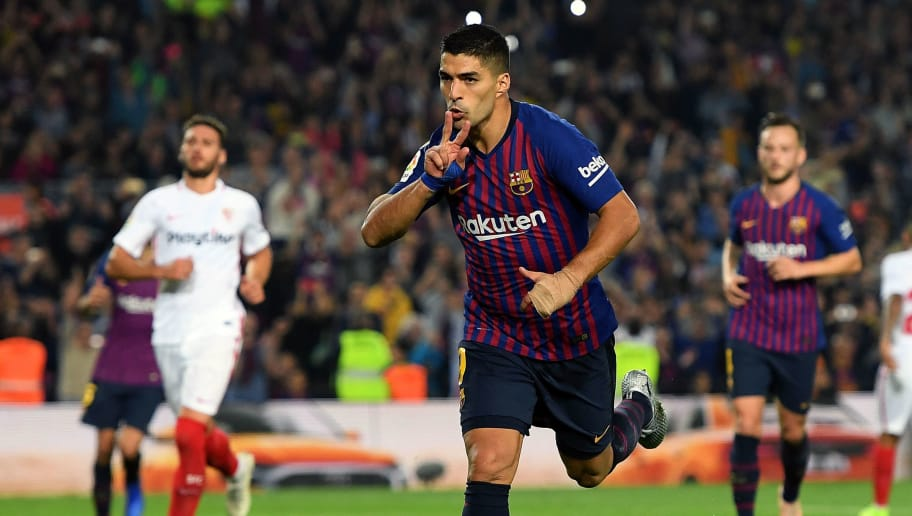 BARCELONA, SPAIN - OCTOBER 20: Luis Suarez of FC Barcelona celebrates as he scores his sides third goal during the La Liga match between FC Barcelona and Sevilla FC at Camp Nou on October 20, 2018 in Barcelona, Spain. (Photo by Alex Caparros/Getty Images)