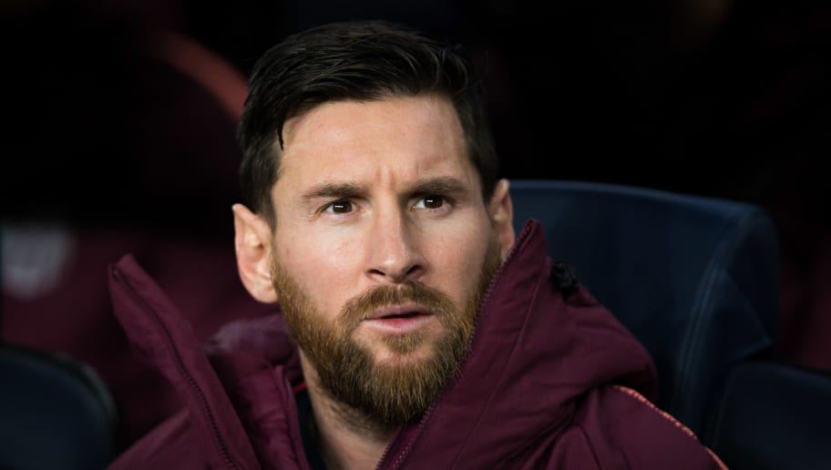 BARCELONA, SPAIN - DECEMBER 11: Lionel Messi of FC Barcelona looks on from the substitutes bench during the UEFA Champions League Group B match between FC Barcelona and Tottenham Hotspur at Camp Nou on December 11, 2018 in Barcelona, Spain. (Photo by Craig Mercer/MB Media/Getty Images)