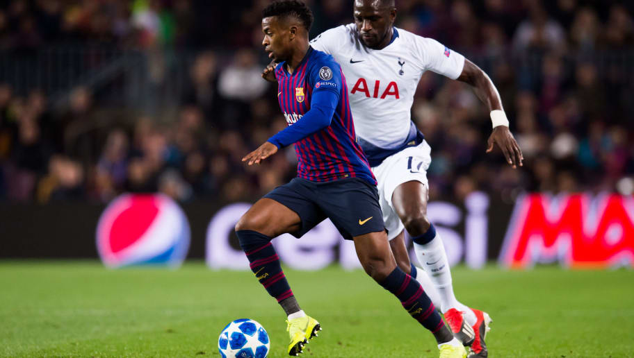 BARCELONA, SPAIN - DECEMBER 11:  Nelson Semedo of Barcelona evades Moussa Sissoko of Tottenham Hotspur during the UEFA Champions League Group B match between FC Barcelona and Tottenham Hotspur at Camp Nou on December 11, 2018 in Barcelona, Spain.  (Photo by Alex Caparros/Getty Images)