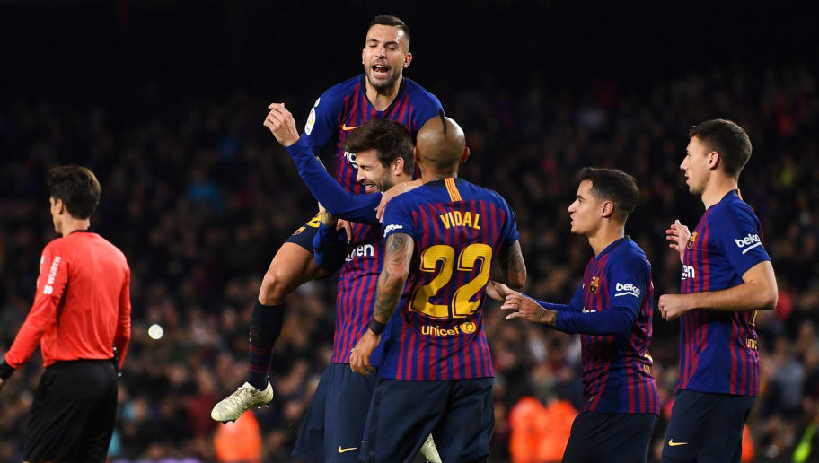 BARCELONA, SPAIN - DECEMBER 02:  Gerard Pique of Barcelona celebrates after scoring his team's first goal with Jordi Alba and team mates during the La Liga match between FC Barcelona and Villarreal CF at Camp Nou on December 2, 2018 in Barcelona, Spain.  (Photo by David Ramos/Getty Images)