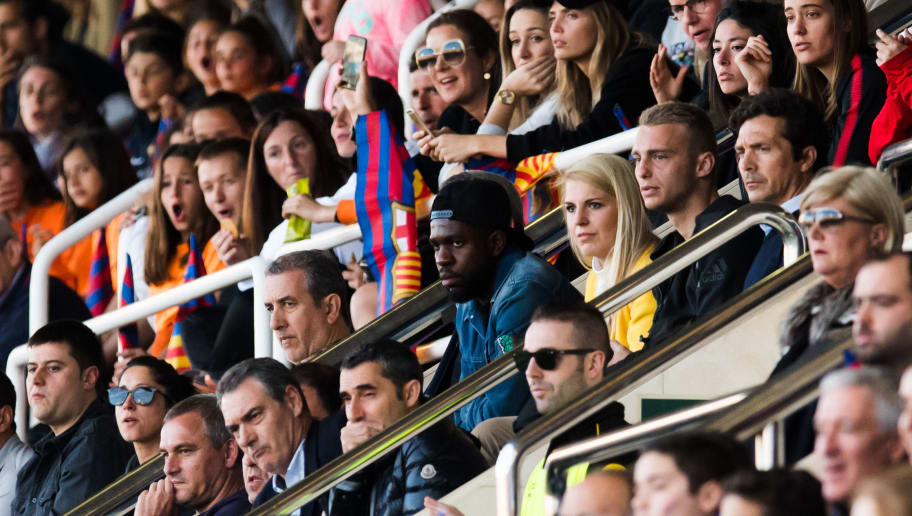 BARCELONA, SPAIN - MARCH 28: Players Samuel Umtiti and Jasper Cillessen of FC Barcelona watch the game next to their Head Coach Ernesto Valverde during the UEFA Women's Champions League Quarter Final 2nd Leg match between FC Barcelona Women and Olympique Lyon Women at Mini Estadi on March 28, 2018 in Barcelona, Spain. (Photo by Alex Caparros/Getty Images)