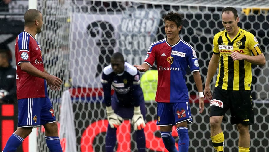 BASEL, SWITZERLAND - AUGUST 31: Yoichiro Kakitani of Basel celebrates after scoring his team's  third goal during the Raiffeisen Super League match between FC Basel and BSC Young Boys Bern at St.Jakob-Park on August 31, 2014 in Basel, Switzerland.