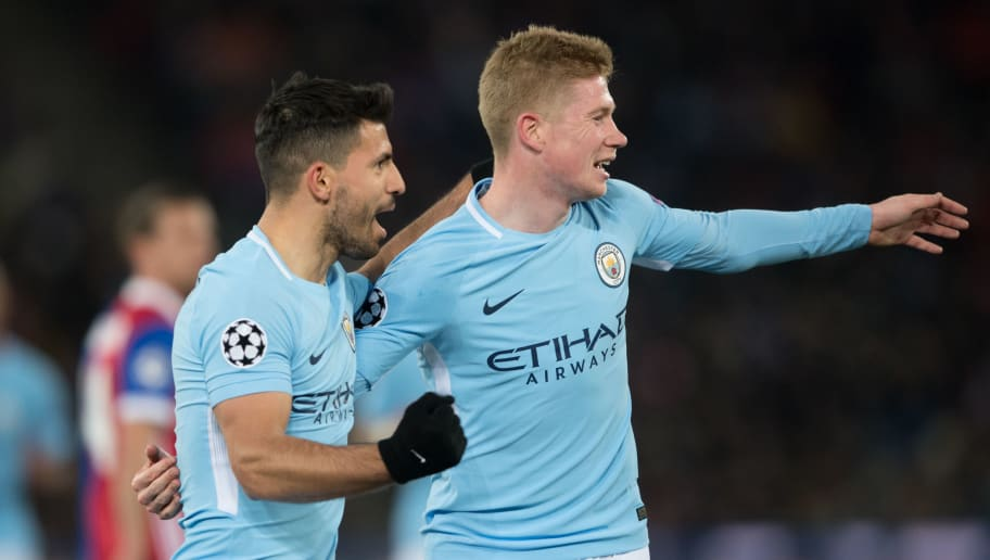BASEL, SWITZERLAND - FEBRUARY 13: Manchester City's Sergio Aguero and Kevin de Bruyne celebrate a goal during the UEFA Champions League Round of 16 First Leg match between FC Basel and Manchester City at St. Jakob-Park on February 13, 2018 in Basel, Switzerland. (Photo by MB Media/Getty Images).