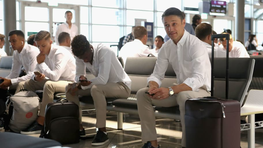 MUNICH, GERMANY - JULY 23:  Team coach Niko Kovac (R) of FC Bayern Muenchen and players wait for their departure to the FC Bayern Muenchen AUDI Summer Tour 2018 to Philadelphia, Pennsylvania, on July 23, 2018 at the Internatonal airport in Munich, Germany.  (Photo by Alexandra Beier/Bongarts/Getty Images)