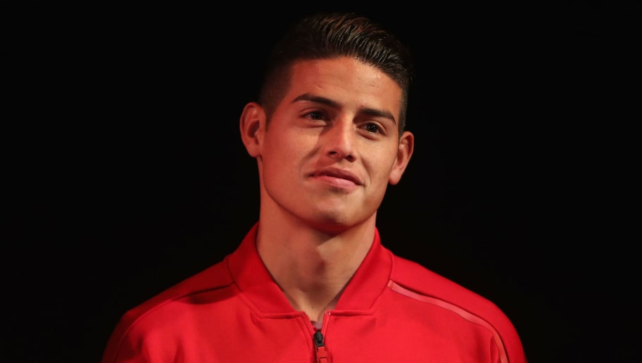 MUNICH, GERMANY - MAY 08:  James Rodriguez of FC Bayern Muenchen smiles during the prsentation of the team's new Adidas home jersey for the upcoming Bundesliga season 2018/19 on May 8, 2018 in Munich, Germany.  (Photo by Alexandra Beier/Bongarts/Getty Images)