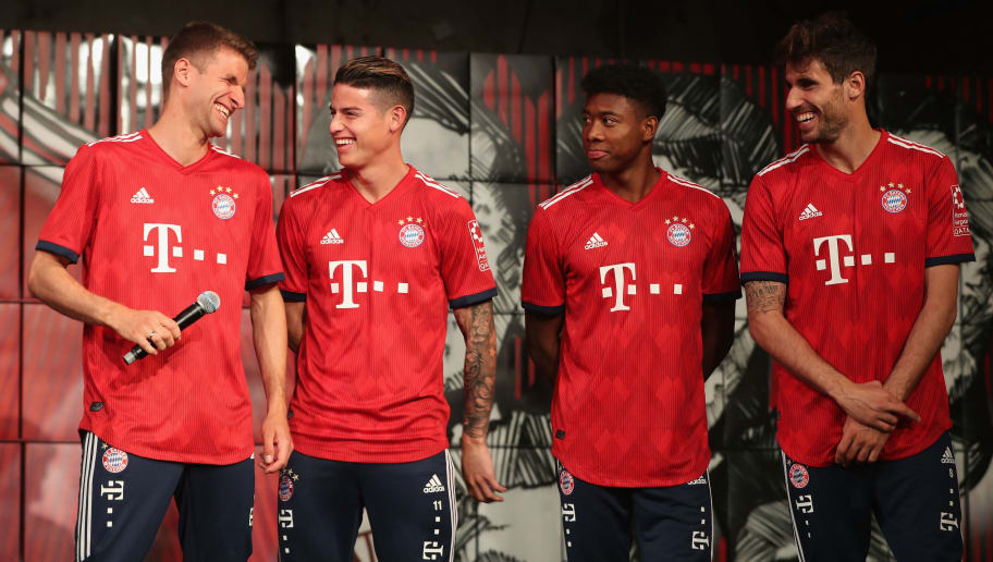 MUNICH, GERMANY - MAY 08:  Thomas Mueller, James Rodriguez, David Alaba and Javi Martinez (L-R) of FC Bayern Muenchen chat after they unveiled the team's Adidas home jersey for the upcoming Bundesliga season 2018/19 during the official presentation on May 8, 2018 in Munich, Germany.  (Photo by Alexandra Beier/Bongarts/Getty Images)