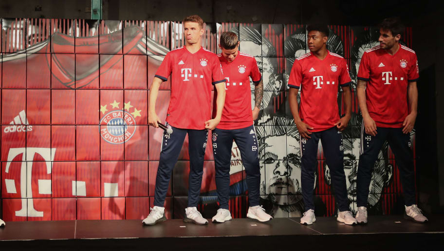MUNICH, GERMANY - MAY 08:  Thomas Mueller, James Rodriguez, David Alaba and Javi Martinez (L-R) of FC Bayern Muenchen are pictured posing with their new unveiled Adidas home jersey for the upcoming Bundesliga season 2018/19 on May 8, 2018 in Munich, Germany.  (Photo by Alexandra Beier/Bongarts/Getty Images)