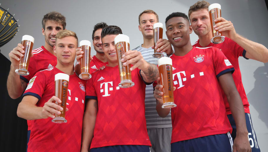 MUNICH, GERMANY - SEPTEMBER 02:  (L-R) Javier Martinez, Joshua Kimmich, Mats Hummels, James Rodriguez, Manuel Neuer, David Alaba and Thomas Mueller of FC Bayern Muenchen during the FC Bayern Muenchen and Paulaner Photo Session at FGV Schmidtle Studios on September 2, 2018 in Munich, Germany.  The traditional photo shoot featuring FC Bayern Muenchen for the Paulaner brewery who have been a platinum partner with Bayern Muenchen since 2003. Giving some of the stars from Germany's record-breaking football team and their trainer Niko Kovac the opportunity to get in touch with some Bavarian culture by dressing for the shoot in Lederhosen the traditional attire of Bavaria.  (Photo by Alexander Hassenstein/Getty Images for Paulaner)