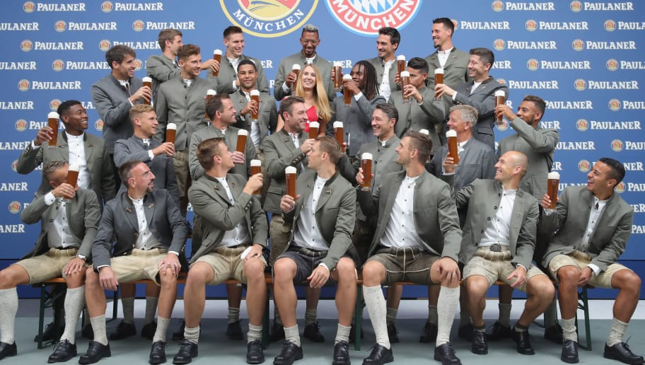 MUNICH, GERMANY - SEPTEMBER 02:  The team of FC Bayern Muenchen pose with the winner Anja Fischer during the FC Bayern Muenchen and Paulaner Photo Session at FGV Schmidtle Studios on September 2, 2018 in Munich, Germany.  The traditional photo shoot featuring FC Bayern Muenchen for the Paulaner brewery who have been a platinum partner with Bayern Muenchen since 2003. Giving some of the stars from Germany's record-breaking football team and their trainer Niko Kovac the opportunity to get in touch with some Bavarian culture by dressing for the shoot in Lederhosen the traditional attire of Bavaria.  (Photo by Alexander Hassenstein/Getty Images for Paulaner)
