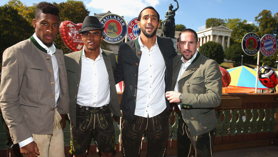 MUNICH, GERMANY - SEPTEMBER 30:  (L-R) Kingsley Coman, Douglas Costa, Medhi Benatia and Franck Ribery of FC Bayern Muenchen attend the Oktoberfest 2015 Beerfestival at Kaefer Wiesenschaenke at Theresienwiese on September 30, 2015 in Munich, Germany.  (Photo by Alexander Hassenstein/Bongarts/Getty Images)