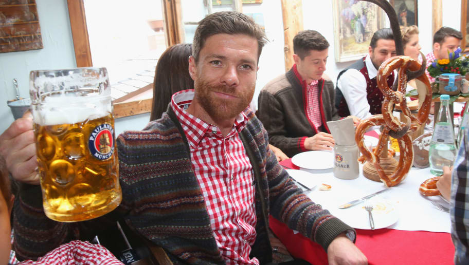 MUNICH, GERMANY - OCTOBER 05:  Xabi Alonso attends the Oktoberfest beer festival at Kaefer Wiesnschaenke tent at Theresienwiese on October 5, 2014 in Munich, Germany.  (Photo by Alexander Hassenstein/Bongarts/Getty Images)