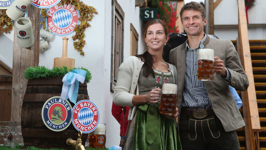 MUNICH, GERMANY - OCTOBER 02:  Thomas Mueller of FC Bayern Muenchen and his wife Lisa attend the Oktoberfest beer festival at Kaefer Wiesenschaenke tent at Theresienwiese on October 2, 2016 in Munich, Germany.  (Photo by Alexandra Beier/Bongarts/Getty Images)