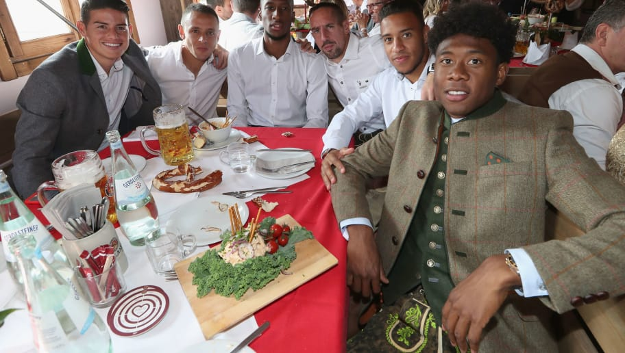 MUNICH, GERMANY - SEPTEMBER 23:  James Rodriguez, Rafinha, Kingsley Coman, Franck Ribery, Corentin Tolisso and David Alaba (L-R) of FC Bayern Muenchen attend the Oktoberfest beer festival at Kaefer Wiesenschaenke tent at Theresienwiese on September 23, 2017 in Munich, Germany.  (Photo by Alexandra Beier/Bongarts/Getty Images)