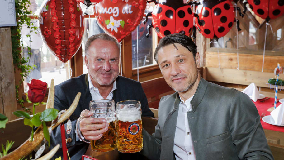 MUNICH, GERMANY - OCTOBER 07: (L-R) Karl-Heinz Rummenigge and Head coach Niko Kovac of Bayern Muenchen attend the Oktoberfest beer festival at Kaefer Wiesenschaenke tent at Theresienwiese on October 7, 2018 in Munich, Germany. (Photo by Pool / Bongarts / Getty Images)