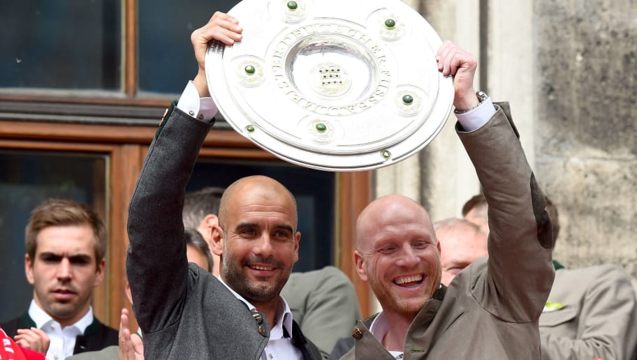 MUNICH, GERMANY - MAY 24:  Head coach Josep Guardiola and manager Matthias Sammer lift the trophy and celebrate winning the Bundesliga at Marienplatz on May 24, 2015 in Munich, Germany.  (Photo by Lars Baron/Bongarts/Getty Images)