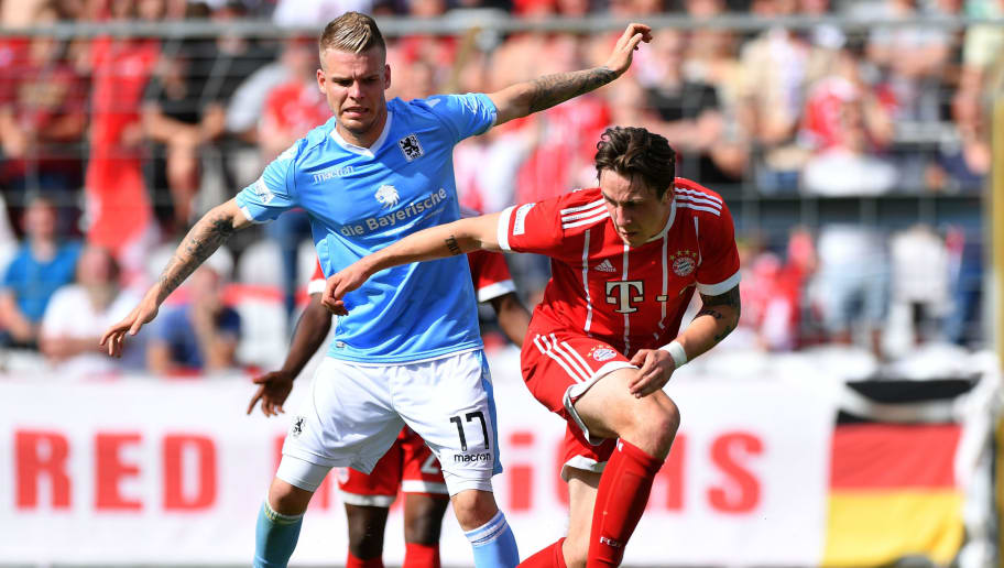 MUNICH, GERMANY - APRIL 29: Daniel Wein of 1860 Muenchen and Adrian Fein of Bayern Meunchen compete for the ball during the Regionalliga Bayern match between FC Bayern Muenchen II and TSV 1860 Muenchen at Stadion an der Gruenwalder Strasse on April 29, 2018 in Munich, Germany. (Photo by Sebastian Widmann/Bongarts/Getty Images)