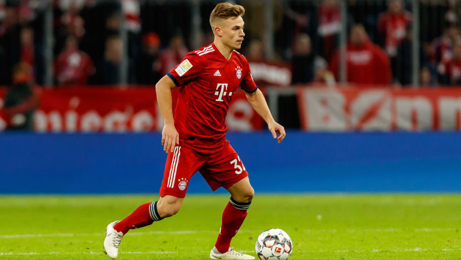 MUNICH, GERMANY - DECEMBER 08: Joshua Kimmich of Bayern Muechen controls the ball during the Bundesliga match between FC Bayern Muenchen and 1. FC Nuernberg at Allianz Arena on December 8, 2018 in Munich, Germany. (Photo by TF-Images/TF-Images via Getty Images)