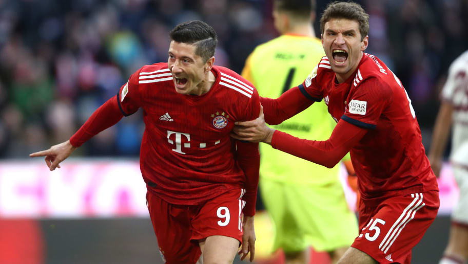MUNICH, GERMANY - DECEMBER 08:  Robert Lewandowski of Bayern Munich celebrates after scoring his teams first goal with Thomas Mueller of Bayern Munich during the Bundesliga match between FC Bayern Muenchen and 1. FC Nuernberg at Allianz Arena on December 8, 2018 in Munich, Germany.  (Photo by Alex Grimm/Bongarts/Getty Images)
