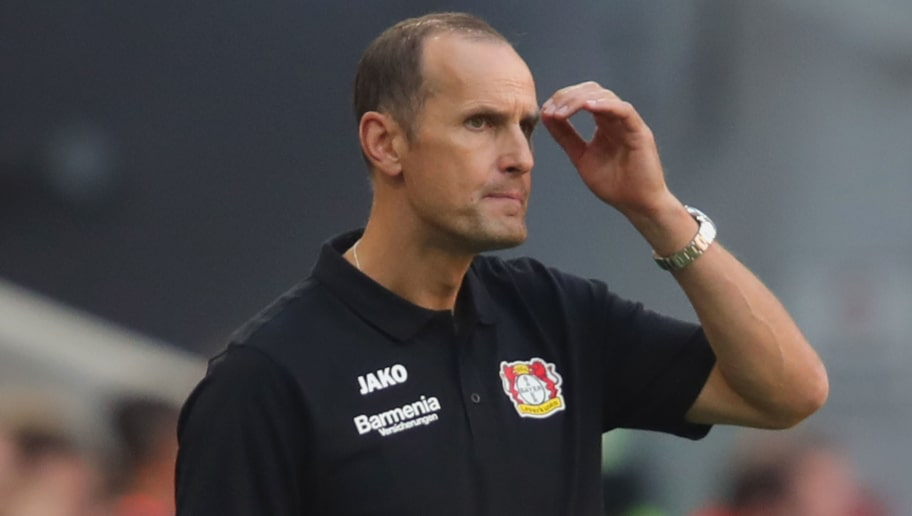 MUNICH, GERMANY - SEPTEMBER 15:  Heiko Herrlich, head coach of Leverkusen reacts during the Bundesliga match between FC Bayern Muenchen and Bayer 04 Leverkusen at Allianz Arena on September 15, 2018 in Munich, Germany.  (Photo by Alexander Hassenstein/Bongarts/Getty Images)