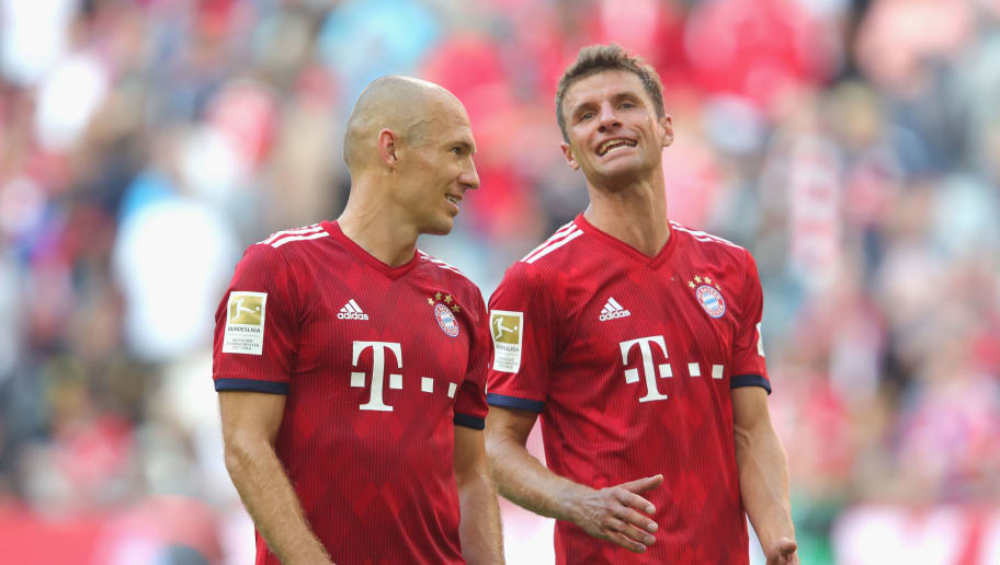 MUNICH, GERMANY - SEPTEMBER 15:  Thomas Mueller  of Muenchen celebrates with his team mate Arjen Robben (L) after  the Bundesliga match between FC Bayern Muenchen and Bayer 04 Leverkusen at Allianz Arena on September 15, 2018 in Munich, Germany.  (Photo by Alexander Hassenstein/Bongarts/Getty Images)