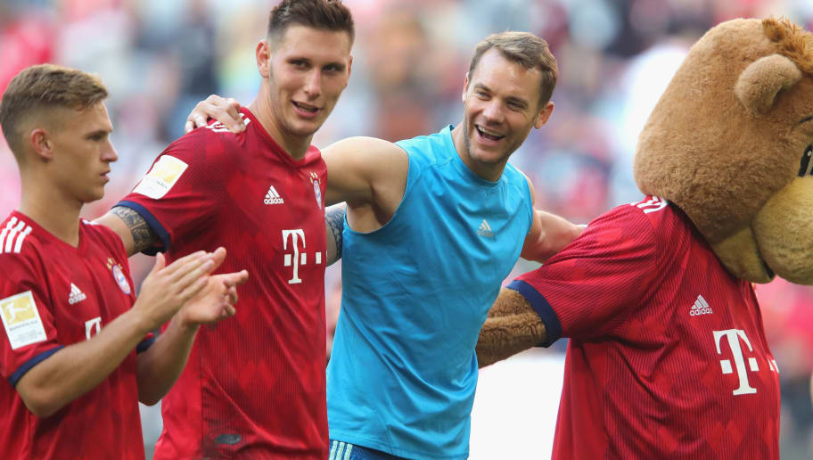 MUNICH, GERMANY - SEPTEMBER 15:  (L-R) Joshua Kimmich, Niklas Suele and Manuel Neuer of Bayern Muenchen celebrate victory after  the Bundesliga match between FC Bayern Muenchen and Bayer 04 Leverkusen at Allianz Arena on September 15, 2018 in Munich, Germany.  (Photo by Alexander Hassenstein/Bongarts/Getty Images)