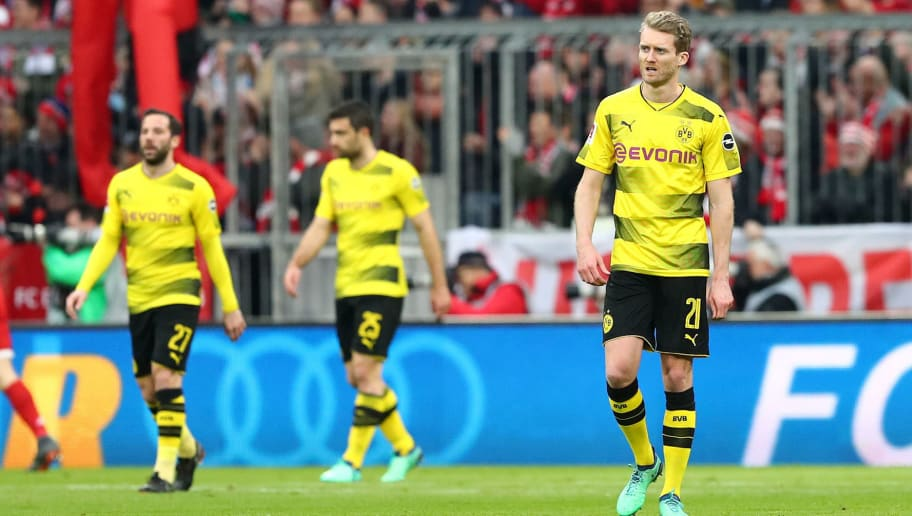 MUNICH, GERMANY - MARCH 31: Gonzalo Castro of Dortmund, Sokratis Papastathopoulos of Dortmund, Andre Schuerrle of Dortmund and Mahmoud Dahoud of Dortmund look dejected during the Bundesliga match between FC Bayern Muenchen and Borussia Dortmund at Allianz Arena on March 31, 2018 in Munich, Germany. (Photo by TF-Images/Getty Images)
