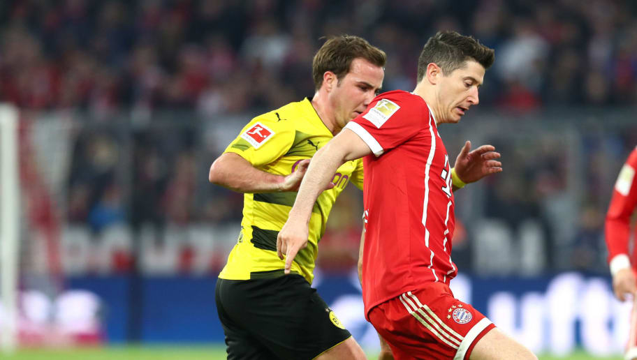 MUNICH, GERMANY - MARCH 31: Mario Goetze of Dortmund and Robert Lewandowski of Muenchen battle for the ball during the Bundesliga match between FC Bayern Muenchen and Borussia Dortmund at Allianz Arena on March 31, 2018 in Munich, Germany. (Photo by TF-Images/Getty Images)