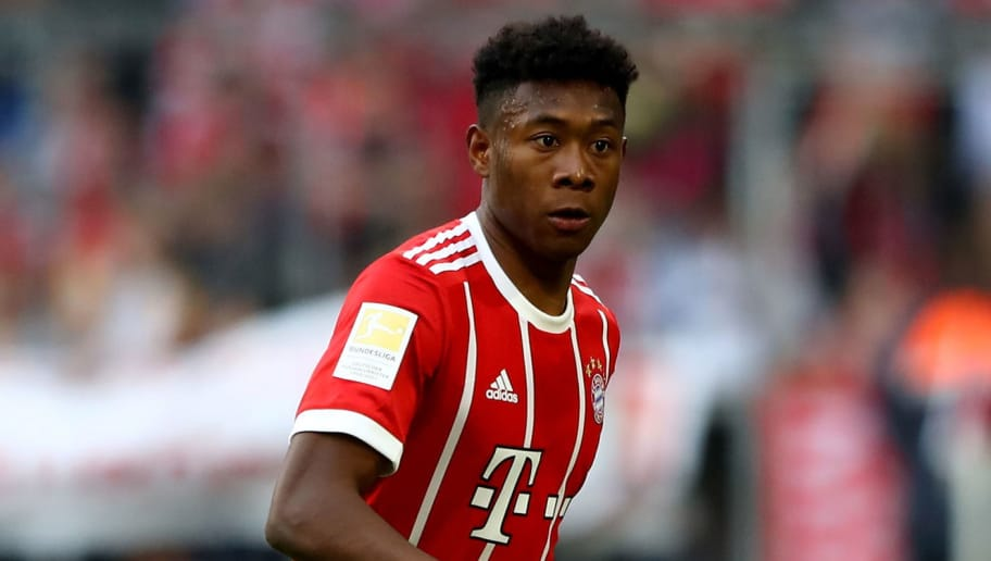 MUNICH, GERMANY - APRIL 14:  David Alaba of Muenchen runs with the ball during the Bundesliga match between FC Bayern Muenchen and Borussia Moenchengladbach at Allianz Arena on April 14, 2018 in Munich, Germany.  (Photo by Martin Rose/Bongarts/Getty Images)