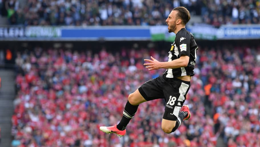 MUNICH, GERMANY - APRIL 14: Josip Drmic of Moenchengladbach celebrates after he scored his teams first goal during the Bundesliga match between FC Bayern Muenchen and Borussia Moenchengladbach at Allianz Arena on April 14, 2018 in Munich, Germany. (Photo by Sebastian Widmann/Bongarts/Getty Images,)