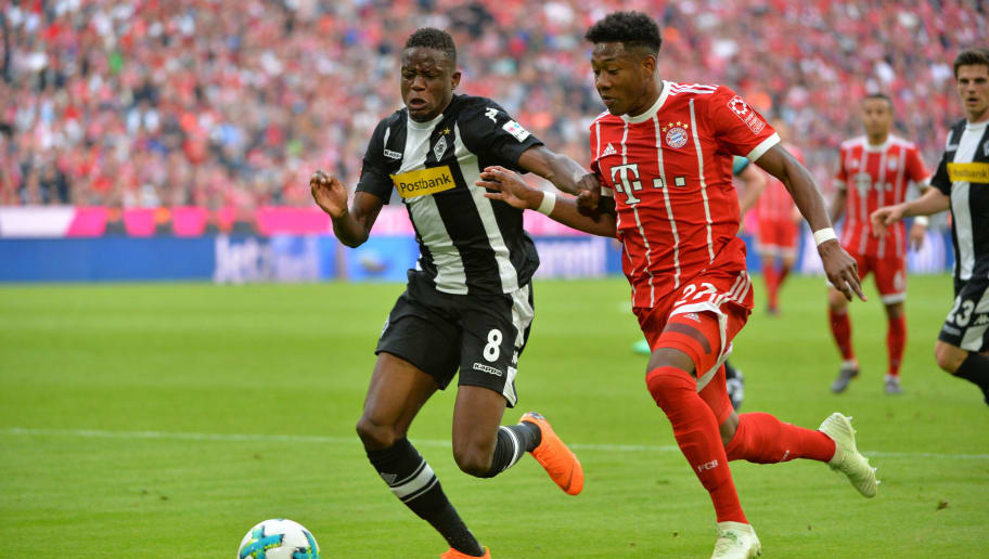 MUNICH, GERMANY - APRIL 14: Denis Zakaria of Moenchengladbach and David Alaba of Muenchen battle for the ball during the Bundesliga match between FC Bayern Muenchen and Borussia Moenchengladbach at Allianz Arena on April 14, 2018 in Munich, Germany. (Photo by TF-Images/Getty Images)