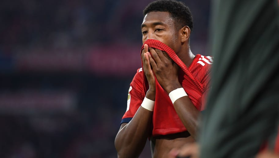 MUNICH, GERMANY - OCTOBER 06:  David Alaba of Bayern Munich reacts after picking up an injury during the Bundesliga match between FC Bayern Muenchen and Borussia Moenchengladbach at Allianz Arena on October 6, 2018 in Munich, Germany.  (Photo by Matthias Hangst/Bongarts/Getty Images)