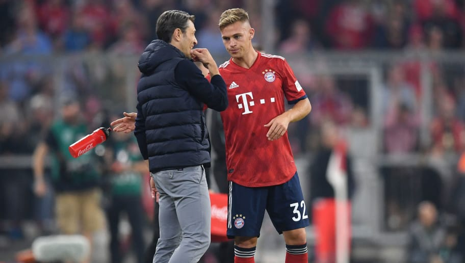 MUNICH, GERMANY - OCTOBER 06:  Niko Kovac, Manager of Bayern Munich gives instructions to Joshua Kimmich of Bayern Munich during the Bundesliga match between FC Bayern Muenchen and Borussia Moenchengladbach at Allianz Arena on October 6, 2018 in Munich, Germany.  (Photo by Matthias Hangst/Bongarts/Getty Images)