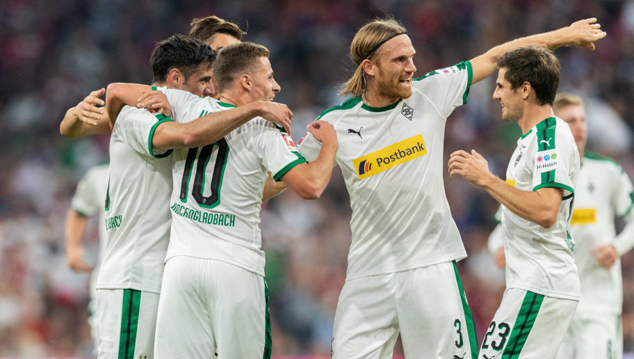 MUNICH, GERMANY - OCTOBER 06: Lars Stindl of Borussia Moenchengladbach celebrates with team mates after scoring his team's second goal during the Bundesliga match between FC Bayern Muenchen and Borussia Moenchengladbach at Allianz Arena on October 6, 2018 in Munich, Germany. (Photo by Boris Streubel/Getty Images)
