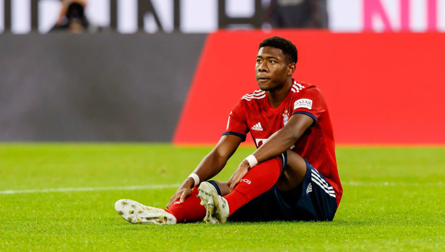 MUNICH, GERMANY - OCTOBER 06: David Alaba of Bayern Muenchen on the ground during the Bundesliga match between FC Bayern Muenchen and Borussia Moenchengladbach at Allianz Arena on October 6, 2018 in Munich, Germany. (Photo by TF-Images/Getty Images)