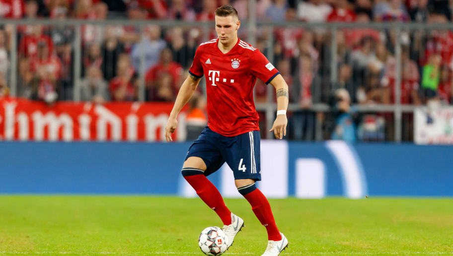 MUNICH, GERMANY - OCTOBER 06: Niklas Suele of Bayern Muenchen controls the ball during the Bundesliga match between FC Bayern Muenchen and Borussia Moenchengladbach at Allianz Arena on October 6, 2018 in Munich, Germany. (Photo by TF-Images/Getty Images)
