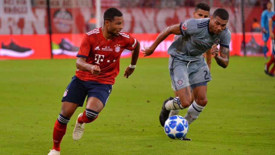 MUNICH, GERMANY - AUGUST 28: Serge Gnabry of Bayern Muenchen and Christian Dean of Chicago Fire battle for the ball during the friendly match between FC Bayern Muenchen and Chicago Fire at Allianz Arena on August 28, 2018 in Munich, Germany. (Photo by TF-Images/Getty Images)