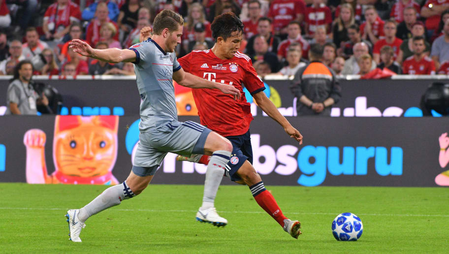 MUNICH, GERMANY - AUGUST 28: Djordje Mihailovic of Chicago Fire and Wooyeong Jeong of Bayern Muenchen battle for the ball during the friendly match between FC Bayern Muenchen and Chicago Fire at Allianz Arena on August 28, 2018 in Munich, Germany. (Photo by TF-Images/Getty Images)