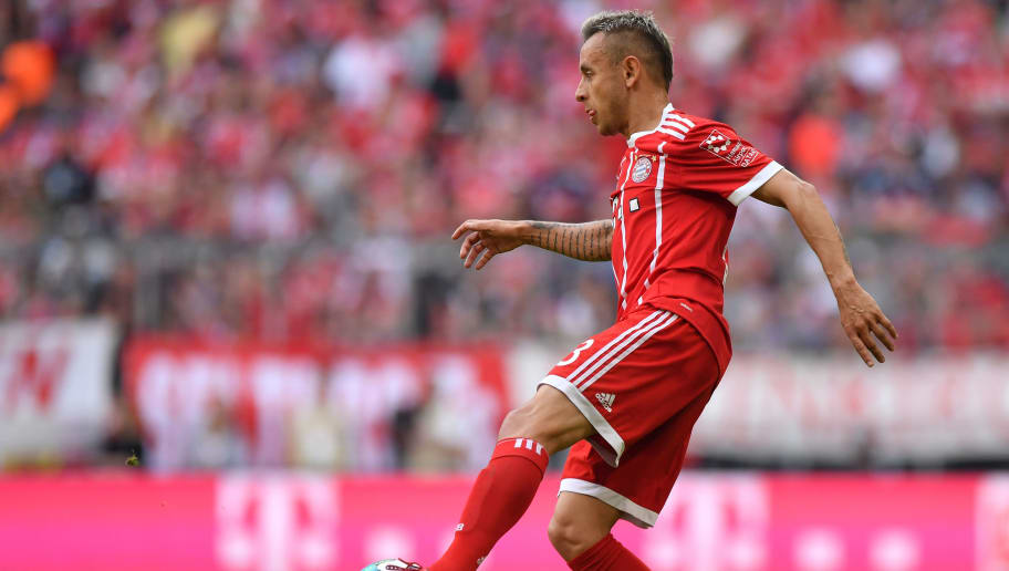 MUNICH, GERMANY - APRIL 28: Rafinha of Bayern Muenchen plays the ball during the Bundesliga match between FC Bayern Muenchen and Eintracht Frankfurt at Allianz Arena on April 28, 2018 in Munich, Germany. (Photo by Sebastian Widmann/Bongarts/Getty Images)