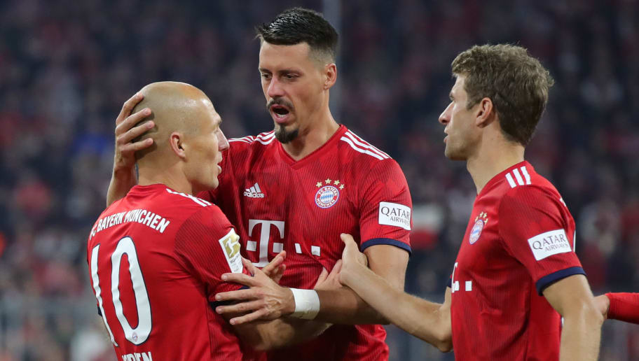 MUNICH, GERMANY - SEPTEMBER 25:  Arjen Robben of Bayern Munich celebrates with team mates after scoring his side's first goal during the Bundesliga match between FC Bayern Muenchen and FC Augsburg at Allianz Arena on September 25, 2018 in Munich, Germany.  (Photo by Alexander Hassenstein/Bongarts/Getty Images)