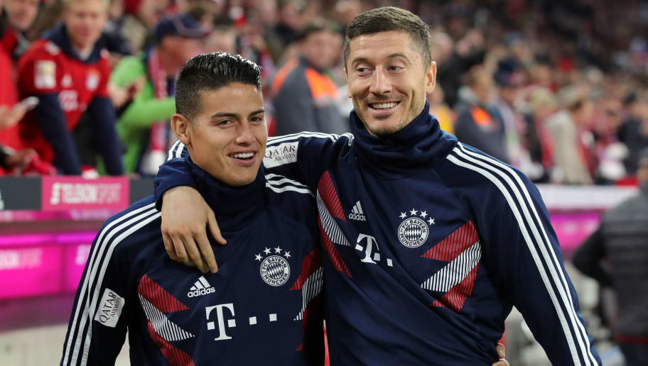 MUNICH, GERMANY - SEPTEMBER 25:  James Rodriguez of Bayern Munich and Robert Lewandowski of Bayern Munich walks to the benches prior to the Bundesliga match between FC Bayern Muenchen and FC Augsburg at Allianz Arena on September 25, 2018 in Munich, Germany.  (Photo by Alexander Hassenstein/Bongarts/Getty Images)