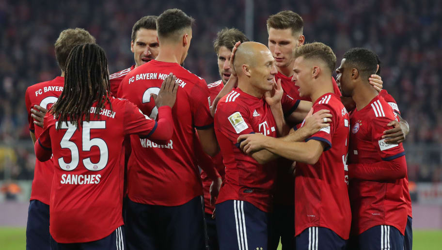 MUNICH, GERMANY - SEPTEMBER 25:  Arjen Robben of Bayern Muenchen celebrates scoring the opening goal with his team mates during the Bundesliga match between FC Bayern Muenchen and FC Augsburg at Allianz Arena on September 25, 2018 in Munich, Germany.  (Photo by Alexander Hassenstein/Bongarts/Getty Images)