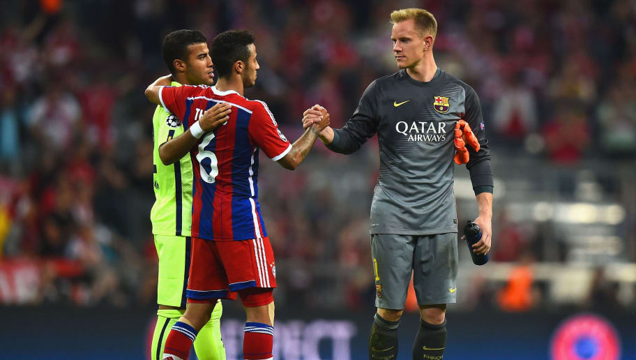MUNICH, GERMANY - MAY 12:  Thiago Alcantara of Bayern Muenchen shakes hands with Marc-Andre ter Stegen of Barcelona after the UEFA Champions League semi final second leg match between FC Bayern Muenchen and FC Barcelona at Allianz Arena on May 12, 2015 in Munich, Germany.  (Photo by Lars Baron/Bongarts/Getty Images)