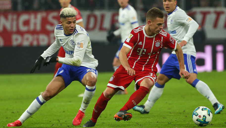 MUNICH, GERMANY - FEBRUARY 10: Amine Harit of Schalke and Joshua Kimmich of Bayern Muenchen battle for the ball during the Bundesliga match between FC Bayern Muenchen and FC Schalke 04 at Allianz Arena on February 10, 2018 in Munich, Germany. (Photo by TF-Images/Getty Images)