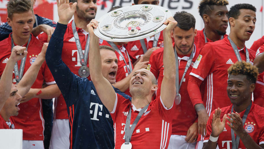 MUNICH, GERMANY - MAY 14:  Arjen Robben of Muenchen lifts the Meisterschale as players and staffs celebrate the Bundesliga championship after the Bundesliga match between FC Bayern Muenchen and Hannover 96 at Allianz Arena on May 14, 2016 in Munich, Germany.  (Photo by Matthias Hangst/Bongarts/Getty Images)