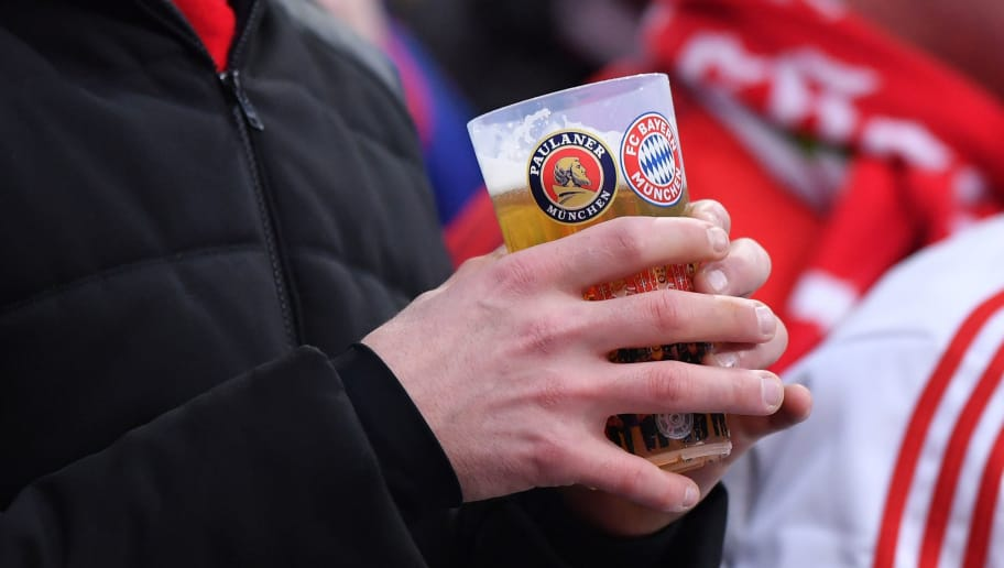 MUNICH, GERMANY - DECEMBER 02: A visitor is holding a recyclable beer cup in his hands during the Bundesliga match between FC Bayern Muenchen and Hannover 96 at Allianz Arena on December 2, 2017 in Munich, Germany. (Photo by Sebastian Widmann/Bongarts/Getty Images)